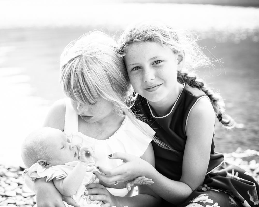 Cuddles for their little sister, newborn portraits Wigton