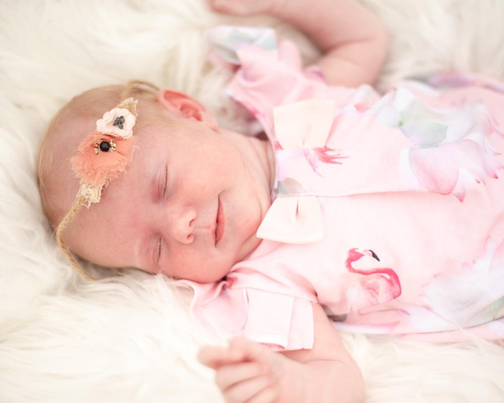 Smiling baby Beatrix, newborn photographer Cockermouth