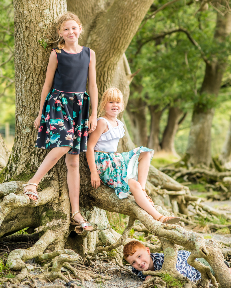 Posing by the tree, baby photographers Cockermouth
