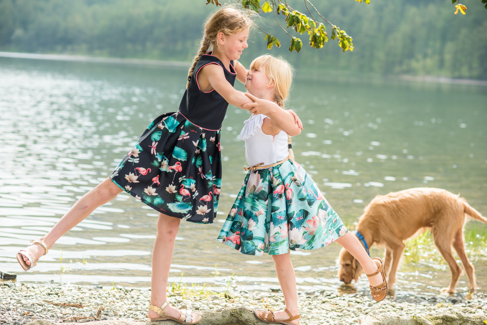 Sisters having fun by the lake. newborn photographer Workington