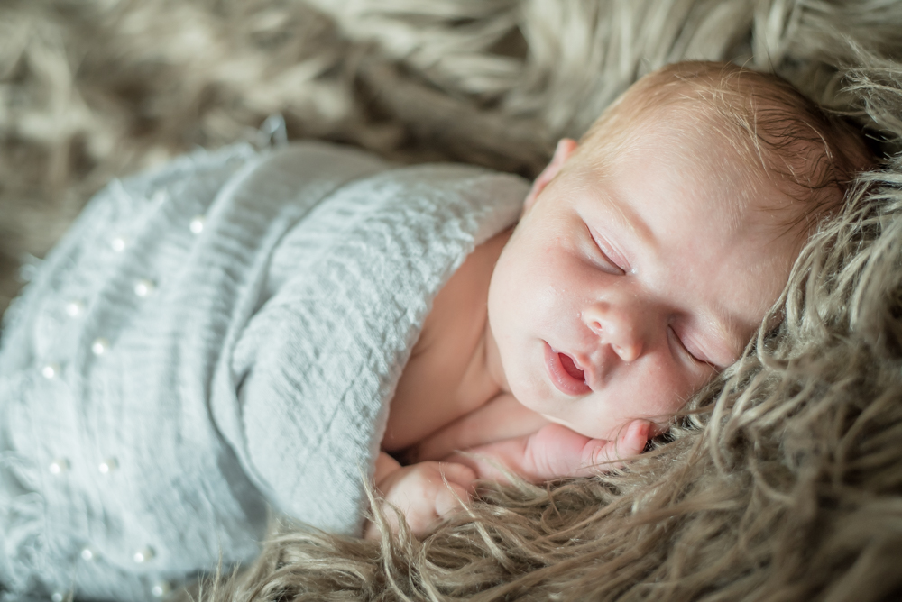 Wrapped up baby in a blanket, newborn photographs at home
