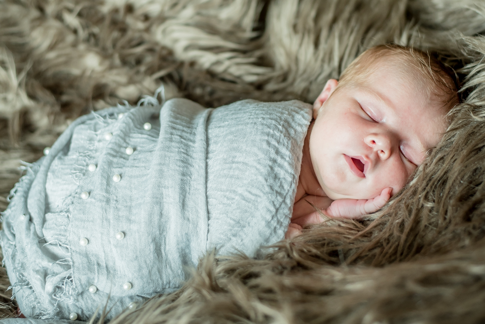 Wrapped in baby blanket. newborn photographs Aspatria