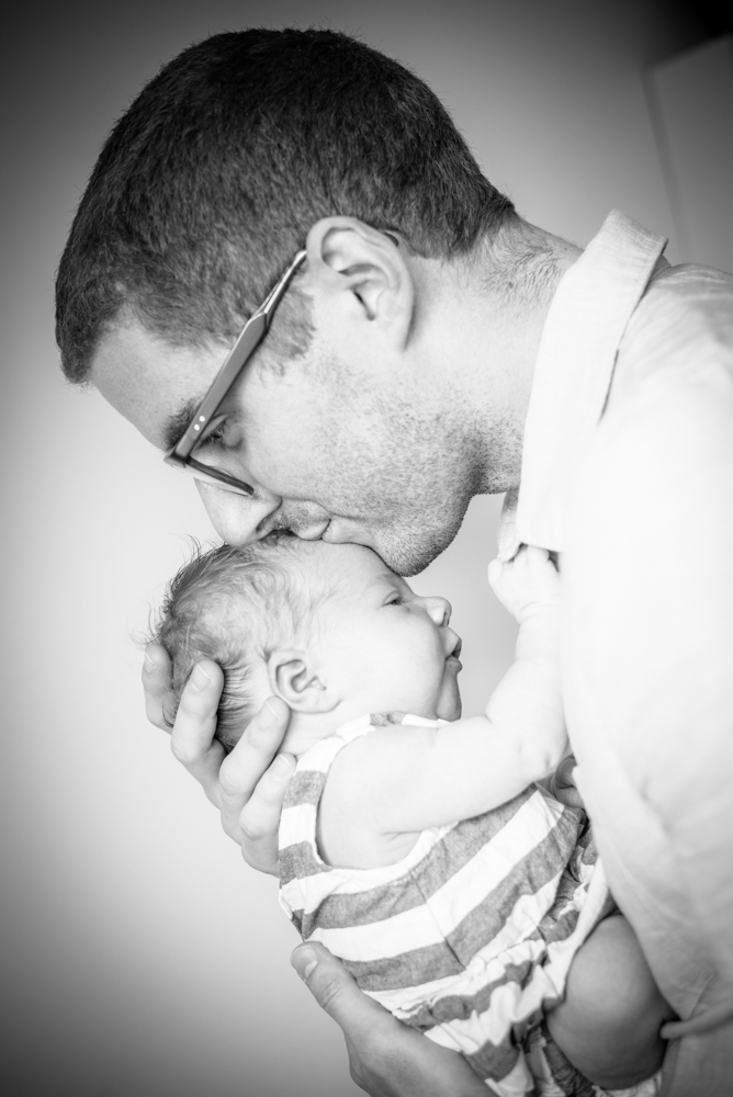 Dad kissing baby. baby photographs in Wigton