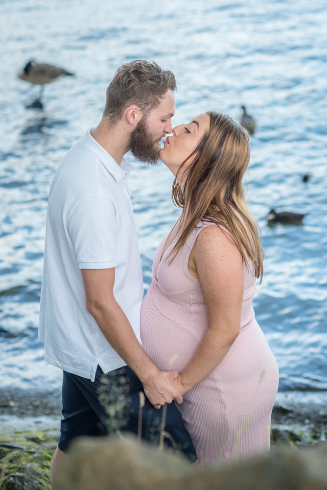 Kissing by the lake, maternity photographs Aspatria