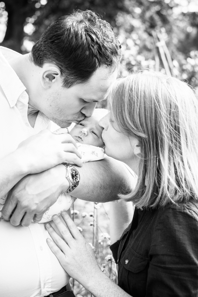 Kisses from Mum and Dad,  family portraits Wigton newborn photographers