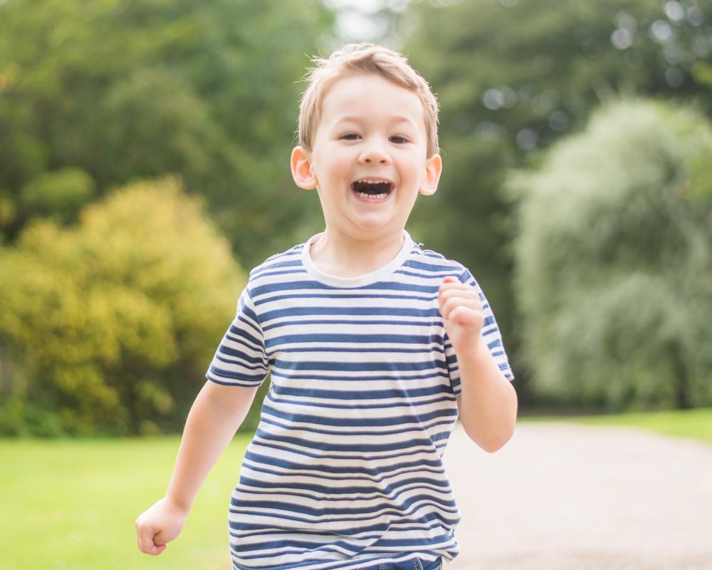 Jacob running through the gardens,  family portraits Sheffield newborn photographers
