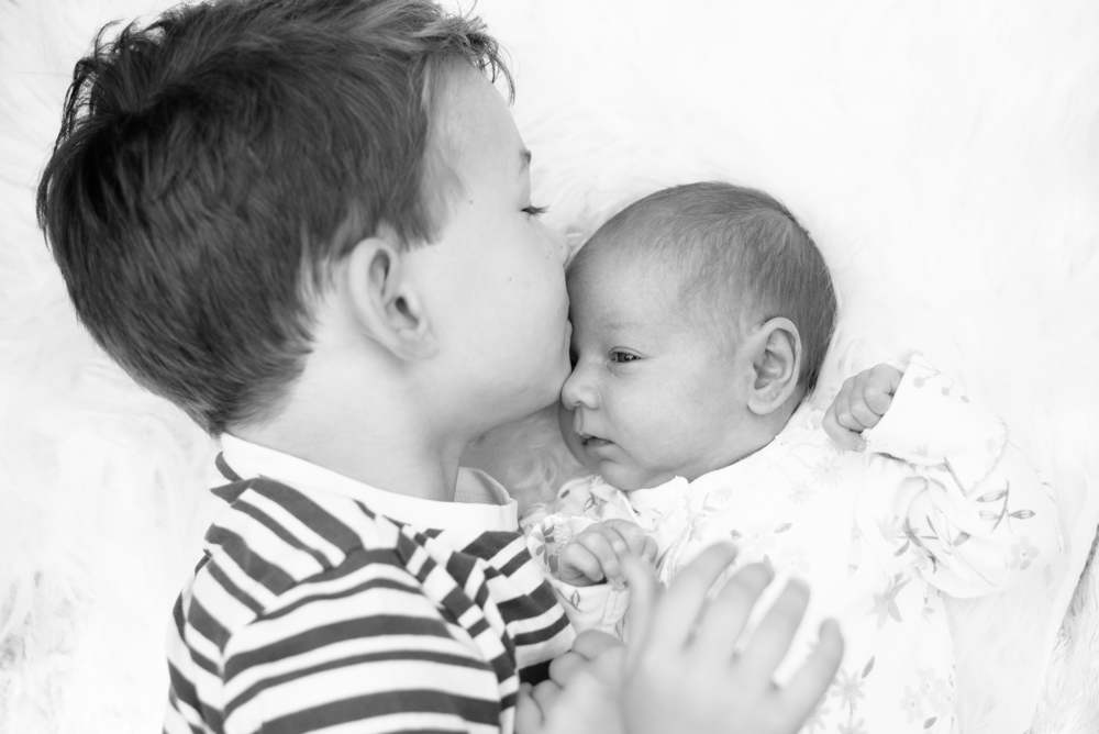 Black and white sibling photo,  family portraits Wigton newborn photographers