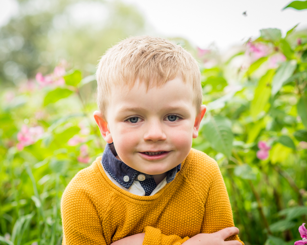 Oliver in flower patch, Aspatria baby photographers