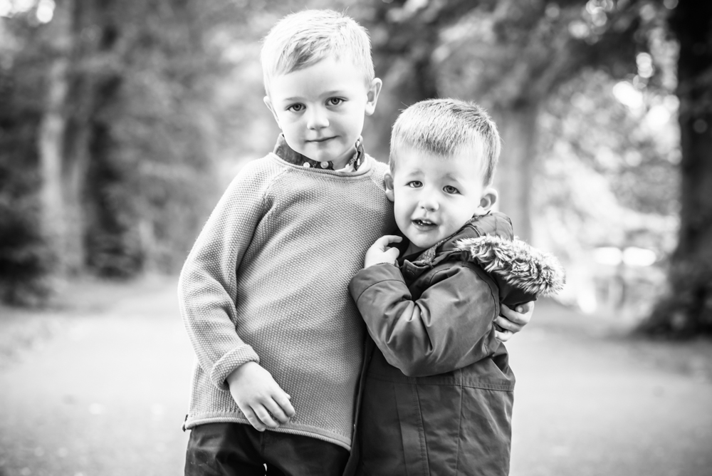 Cousins cuddle, newborn photographer Carlisle