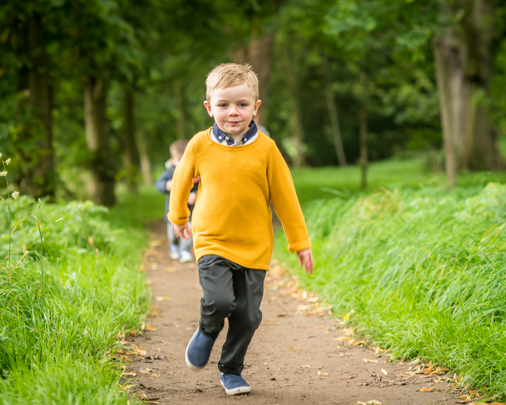 Running Oliver, baby photographers Carlisle
