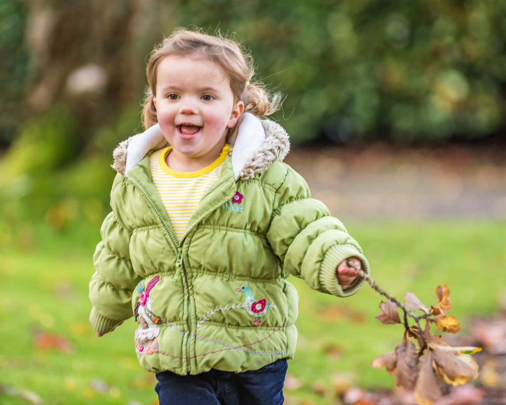 Jessie running with leaves, Autumn portraits Cumbria