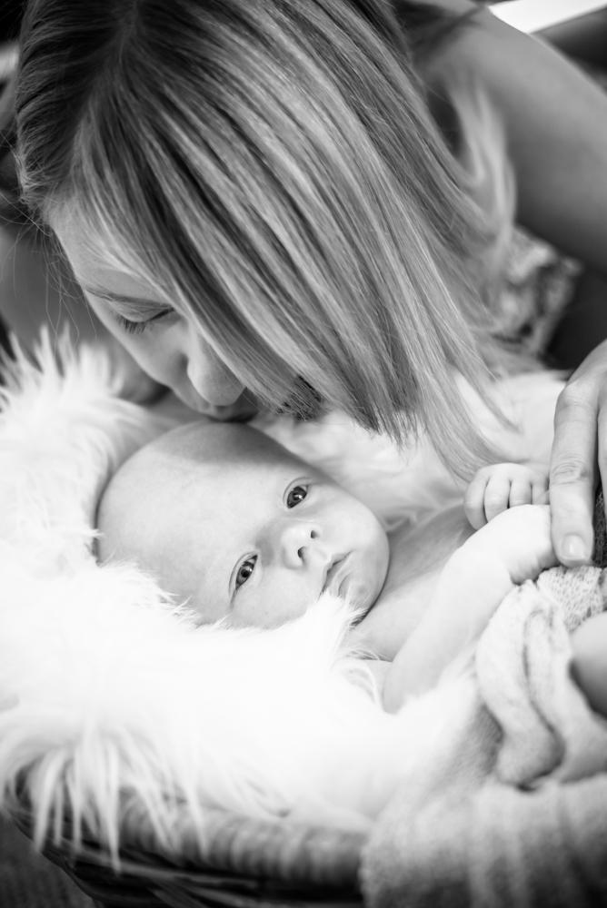 Mum kissing baby Freddie, Cockermouth photographers
