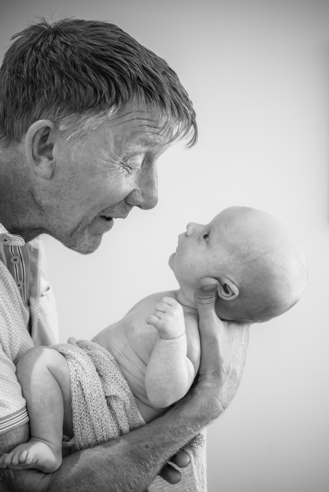 Dad holding baby Freddie, Maryport baby photographers