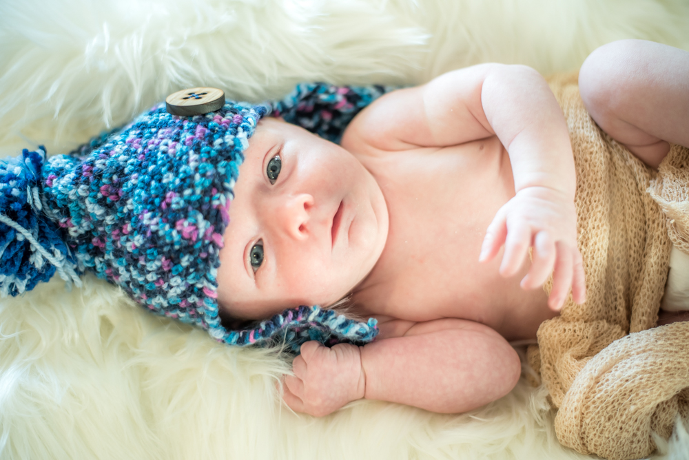 Freddie in a blue hat, newborn portraits Cockermouth