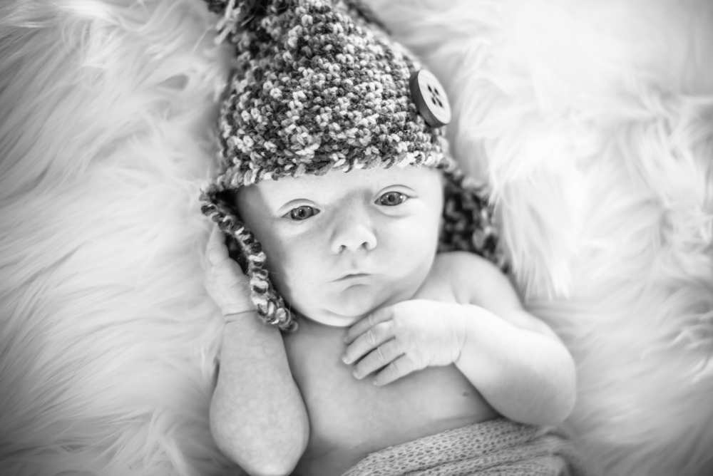 Posing with hat, newborn photographer Wigton