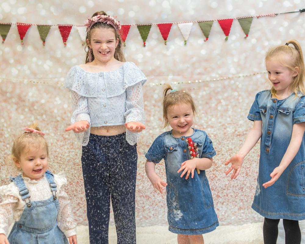 Sisters throwing snow, Christmas mini portraits Carlisle