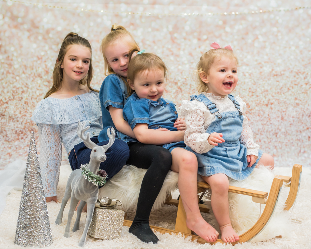 Sisters posing on the sleigh, baby portraits Cumbria