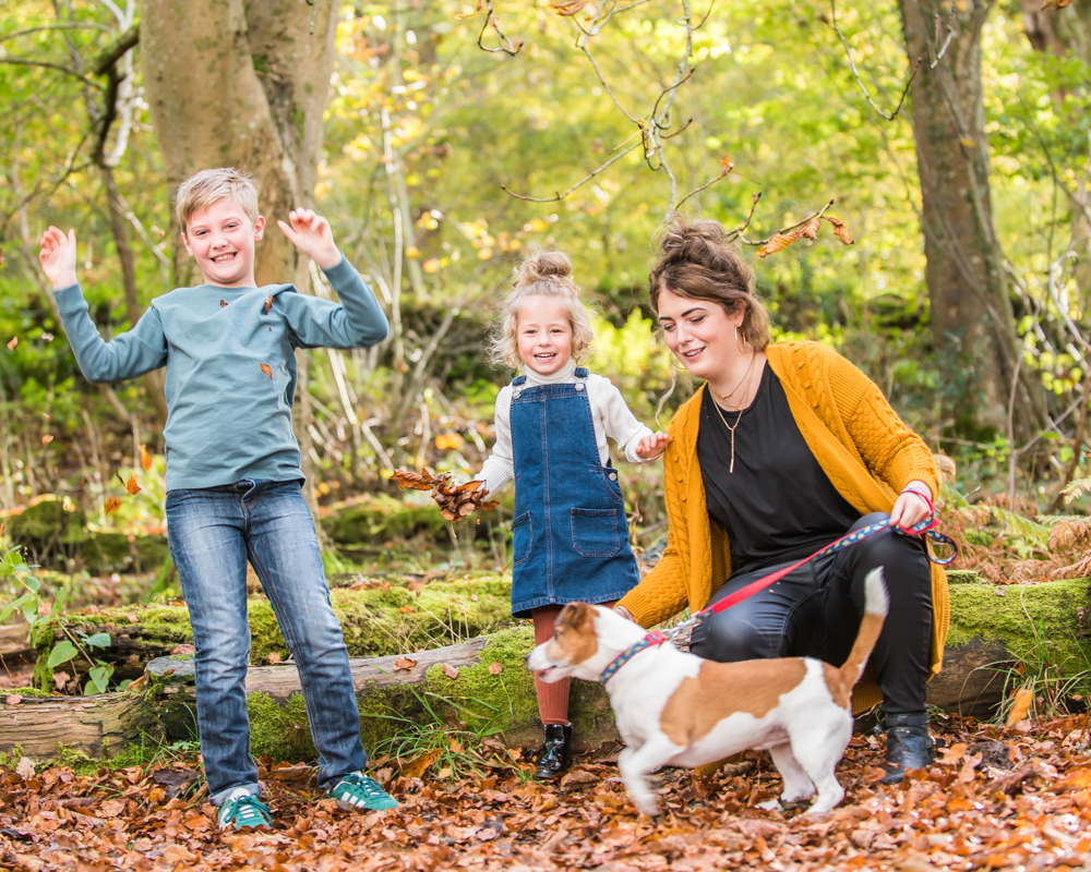 Dog loves leaf throwing, Lake District family photographers