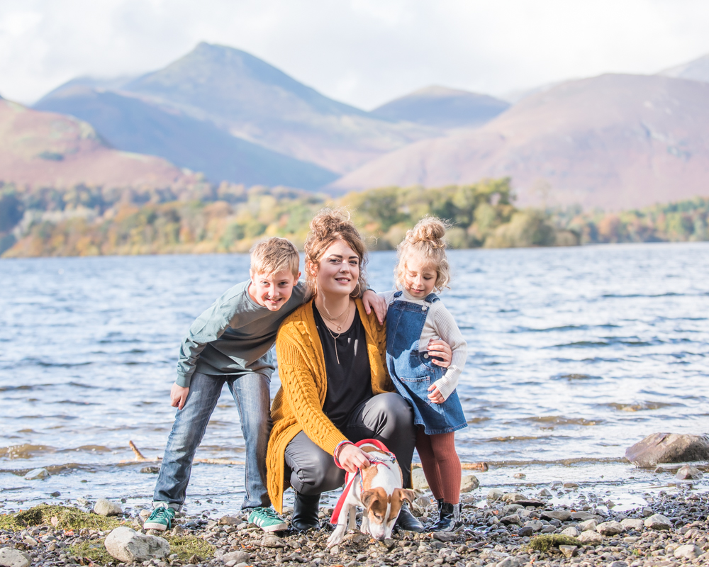 Family posing by lake, Lake District family photographers
