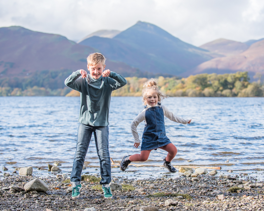 Jumping by Derwentwater, Lake District family photographers