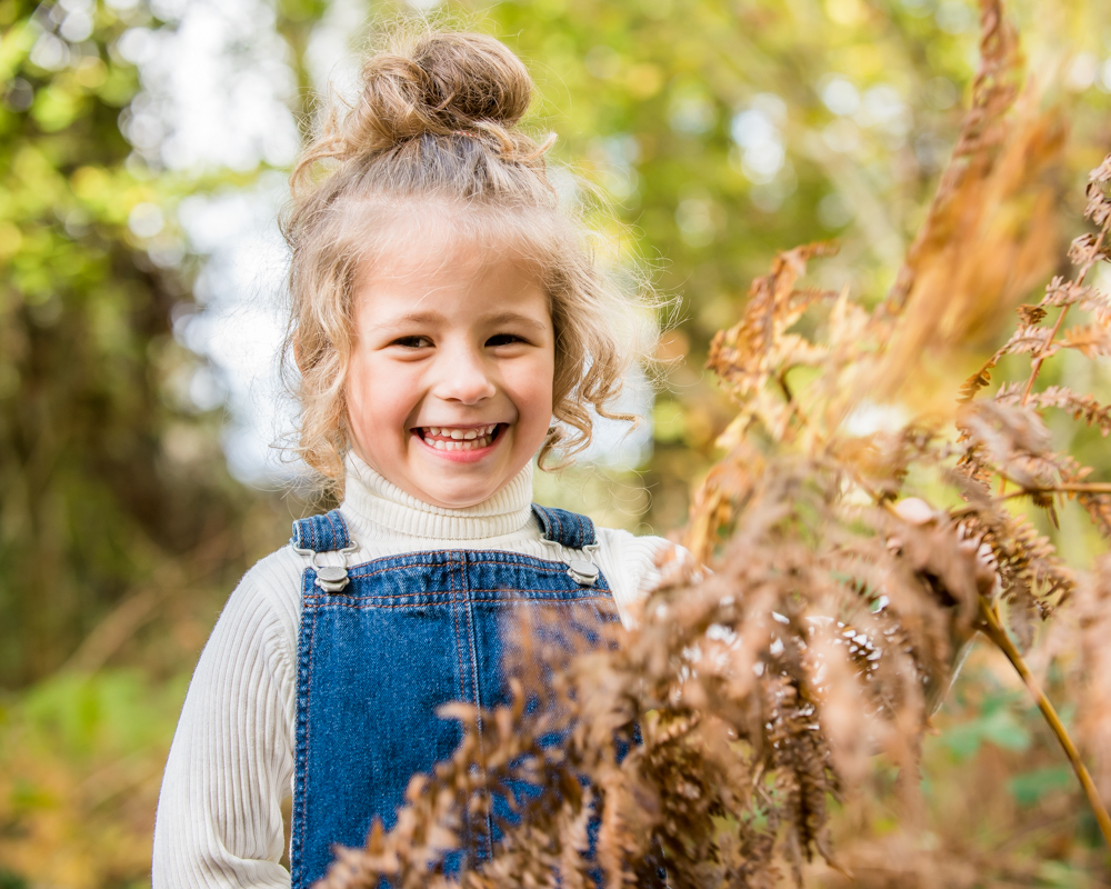 Portraits hiding in woods, Lake District family photographers
