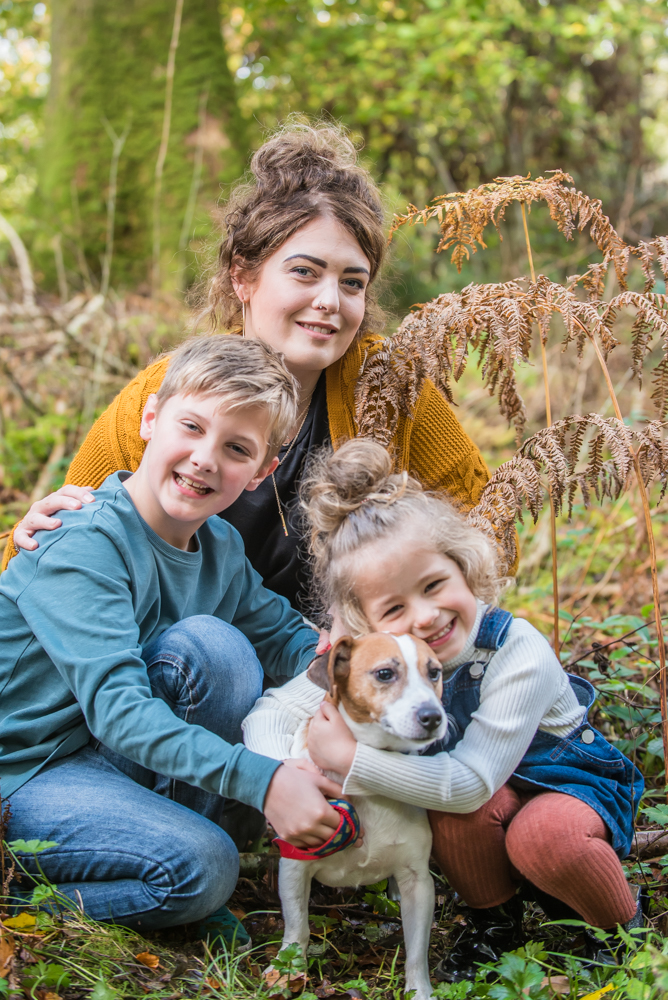 Family cuddle with dog, Lake District family photographers