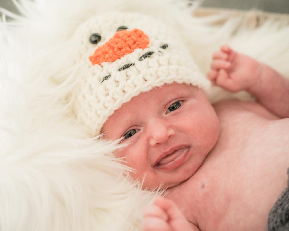 Baby in snowman hat, newborn photographer Cockermouth