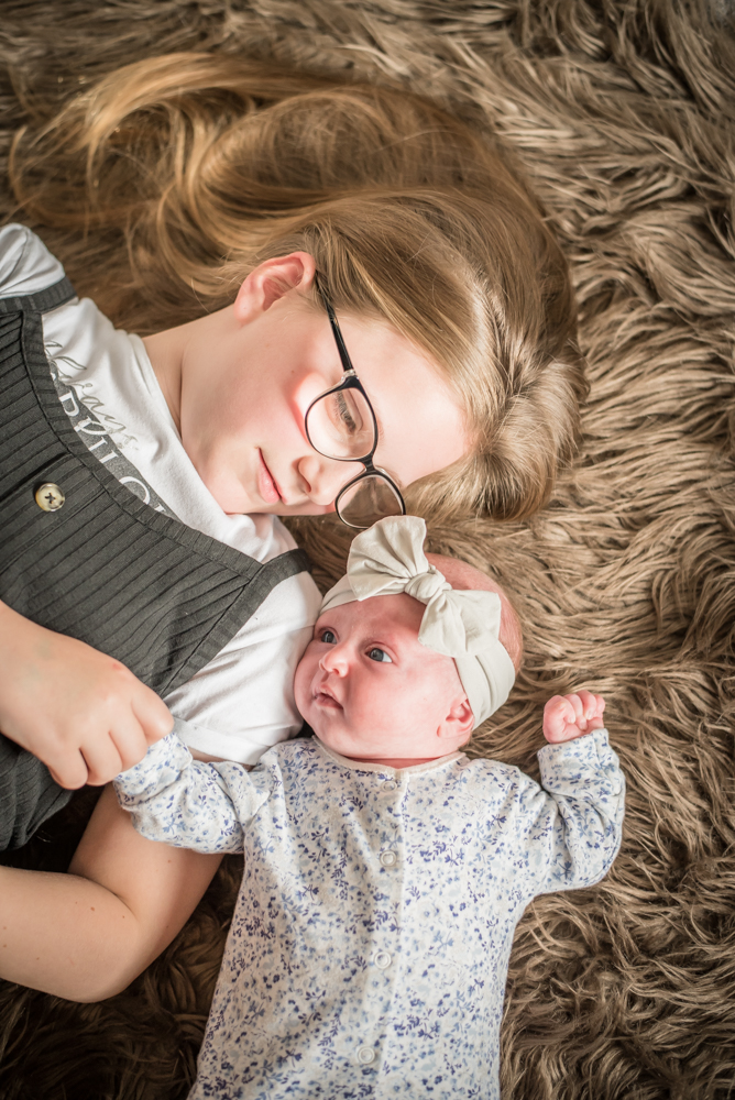 Cuddles with sister, baby photographer Workington