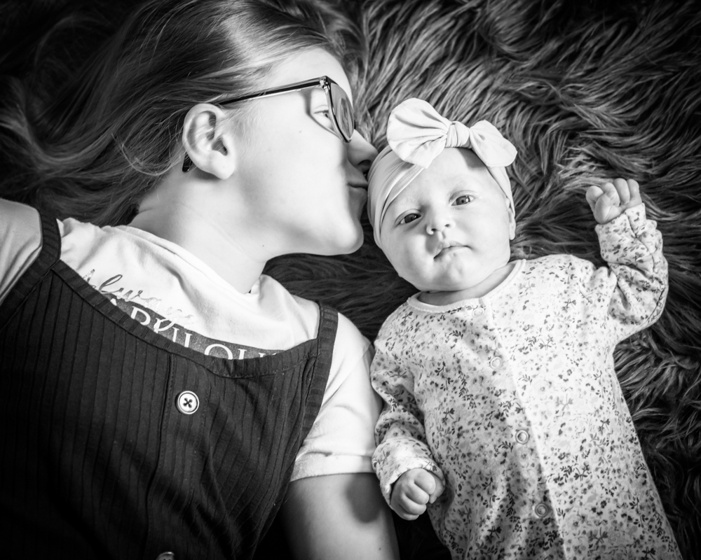Kisses from big sister, newborn photographer Cockermouth