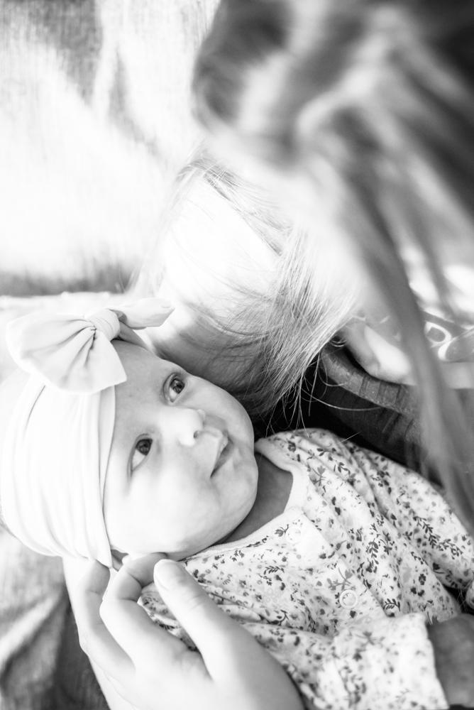 Looking at big sister, baby photos carlisle