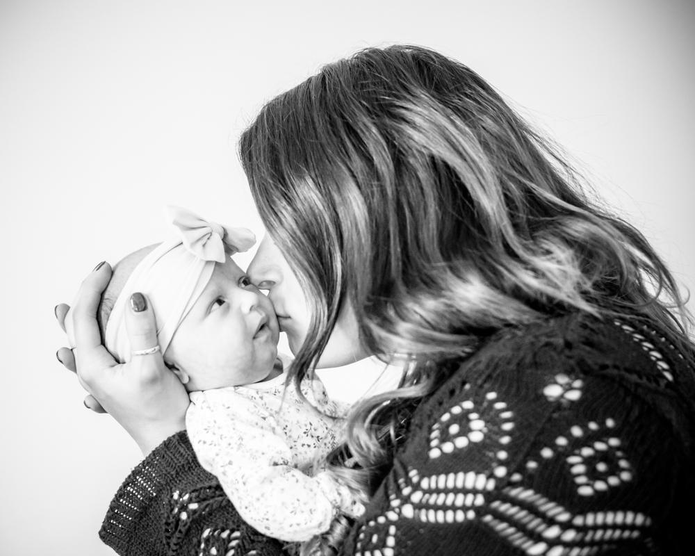 Mama kisses and cuddles, newborn photographer Cockermouth