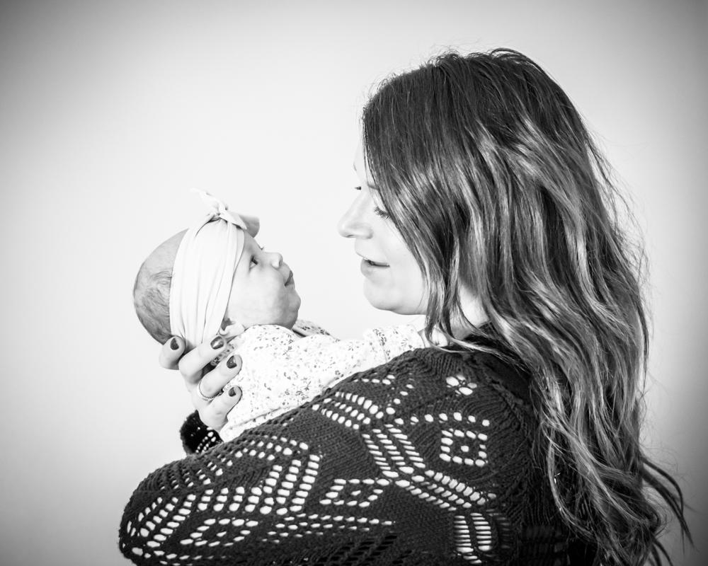 Comforting cuddles from Mum, baby photographer Carlisle