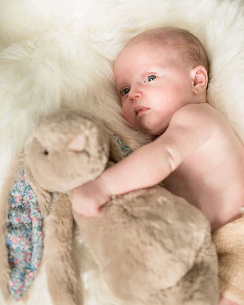 Baby cuddling toy rabbit, newborn photographer Carlisle