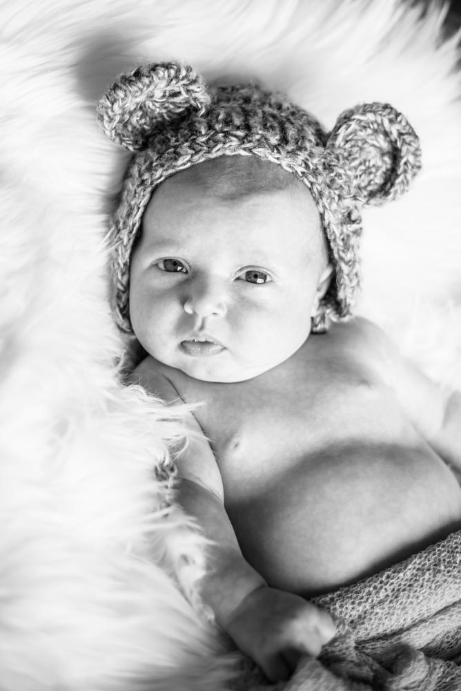 Baby looking at camera, newborn portraits Cumbria