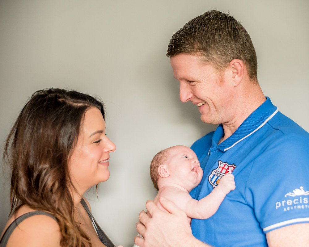 Family cuddle, newborn photographer Wigton