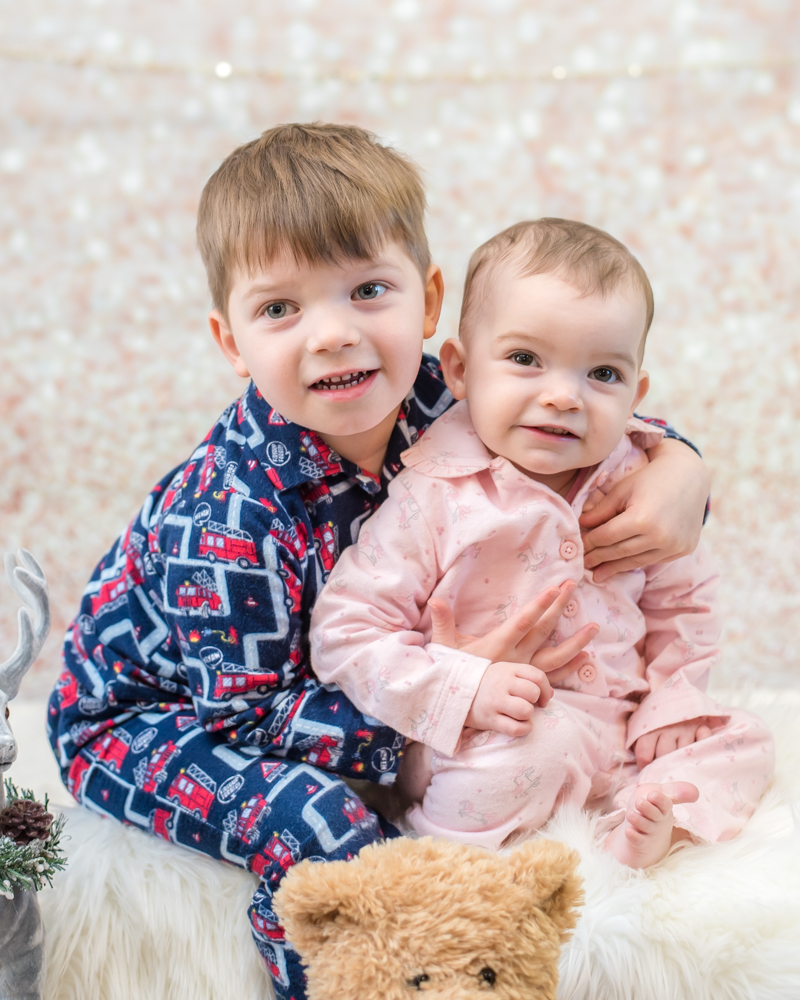 PJ cuddles for siblings, baby photographer Cockermouth