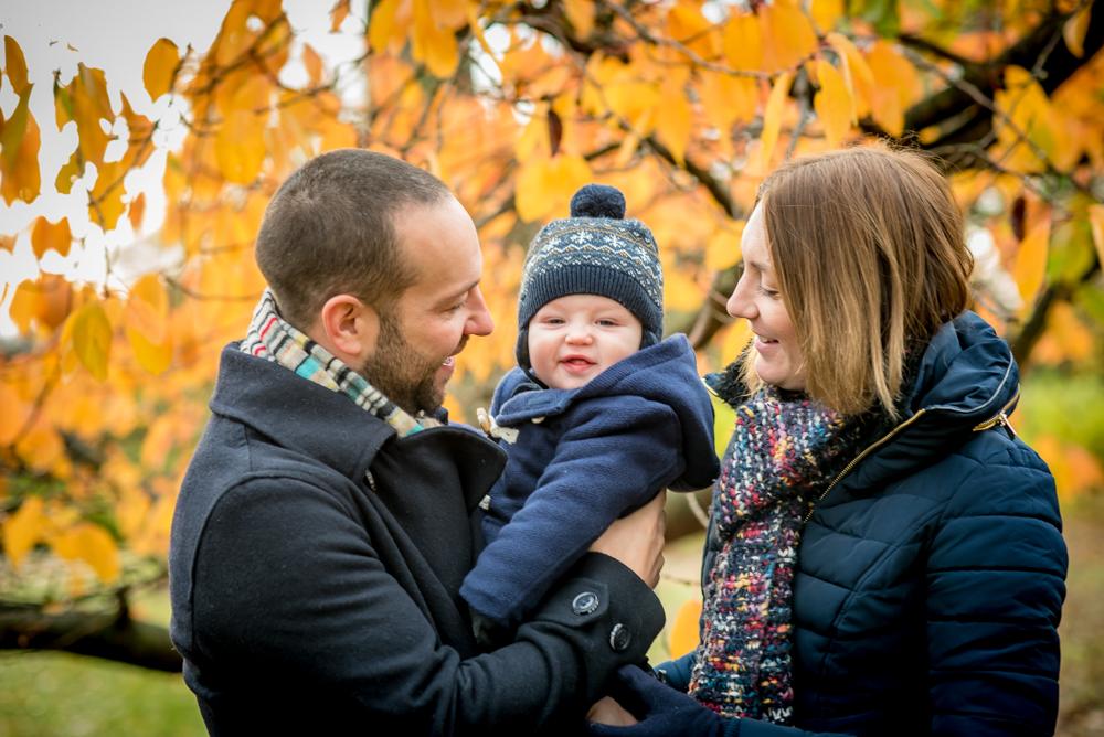 Hugo cuddles with Mum & Dad, Lake District family photographers