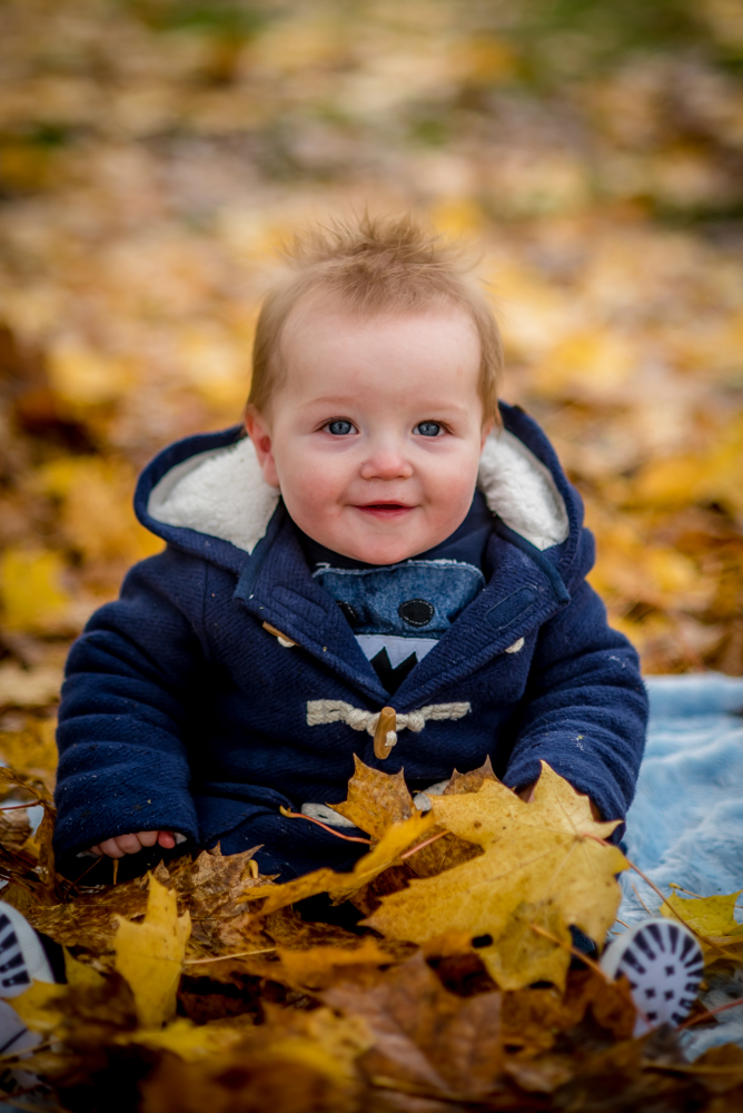 Smiling Hugo in leaf pile, Carlisle family photographers