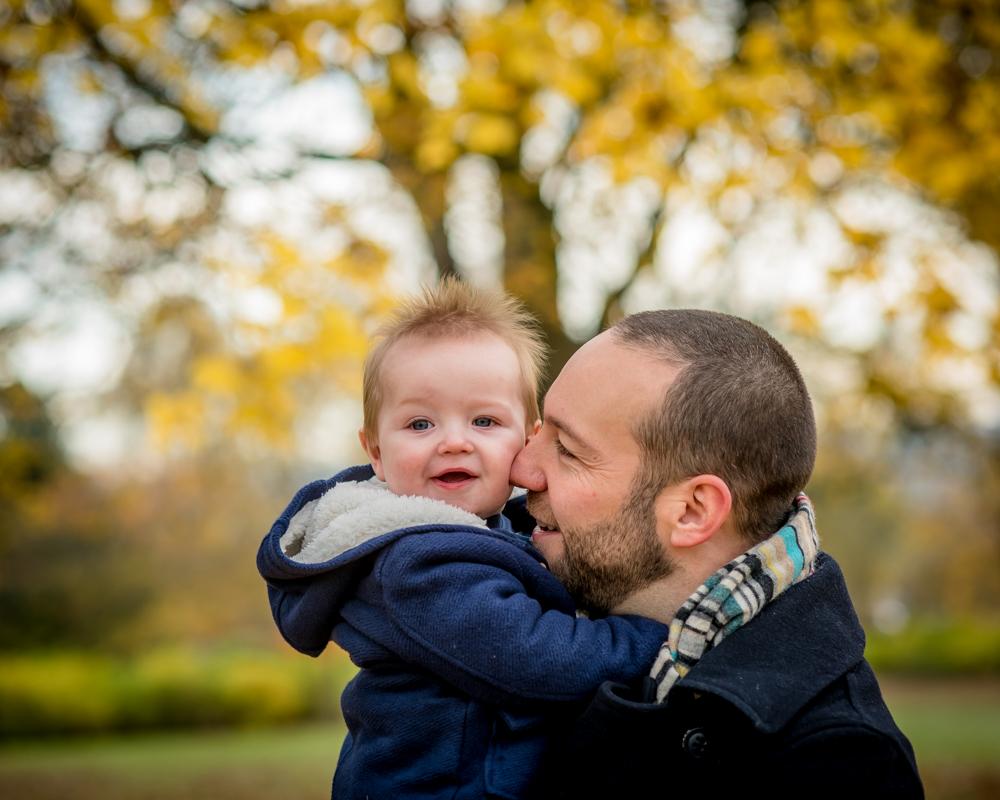 Dad snuggling Hugo, baby photographer Cockermouth