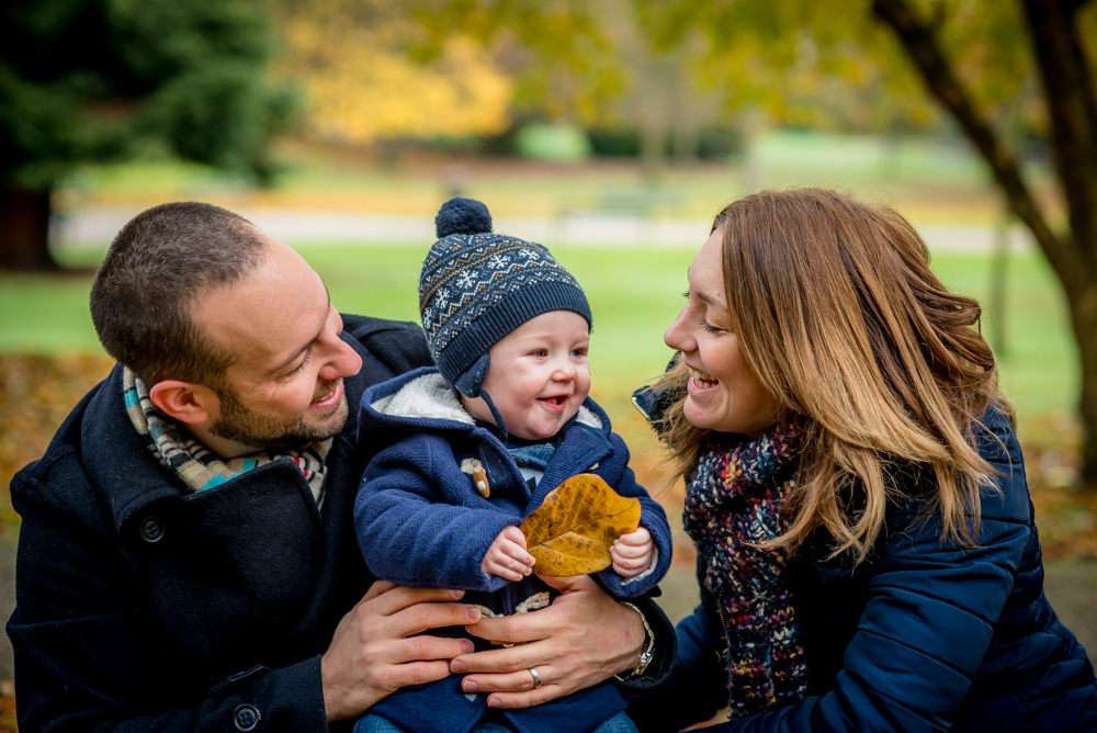 Smiles holding leaves, baby photographer Workington