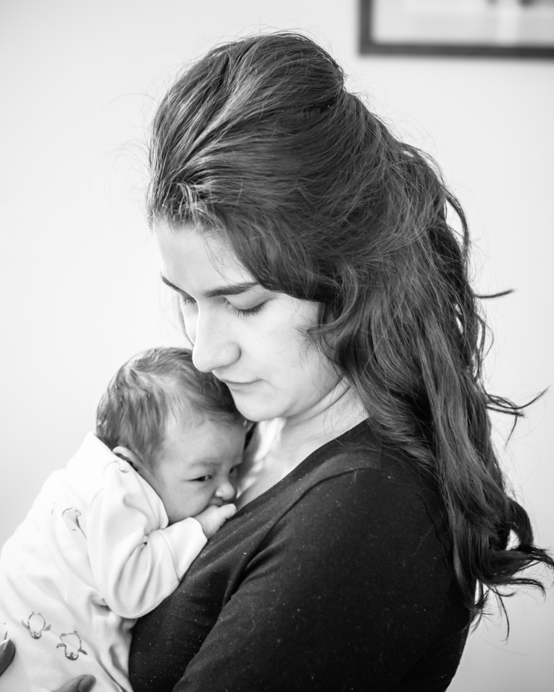 Snuggling into Mum, baby photographer Workington