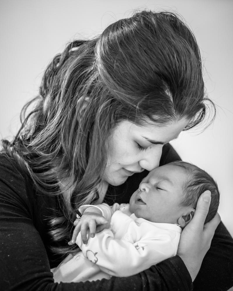Mum cradling baby, newborn photographer Carlisle