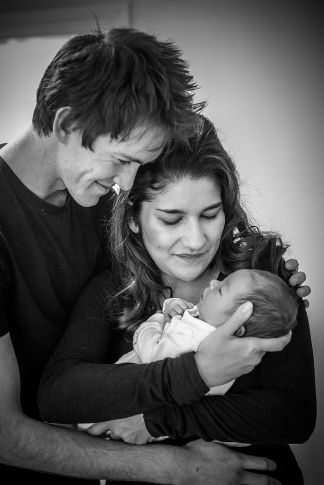 Parents posing with baby. newborn photographer Cumbria