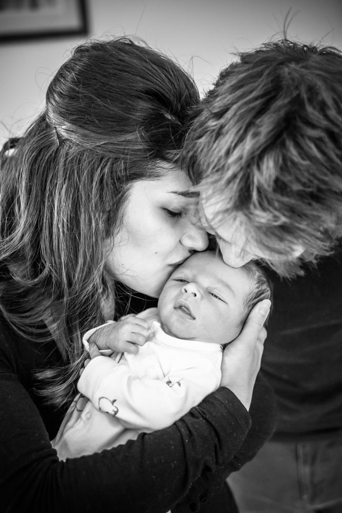 Mum and Dad kissing baby, Carlisle photographers