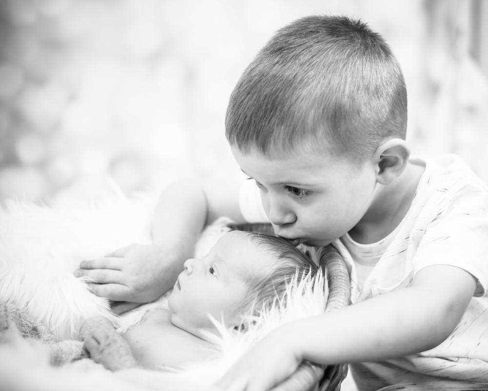 Kisses for baby sister, newborn photographer Carlisle