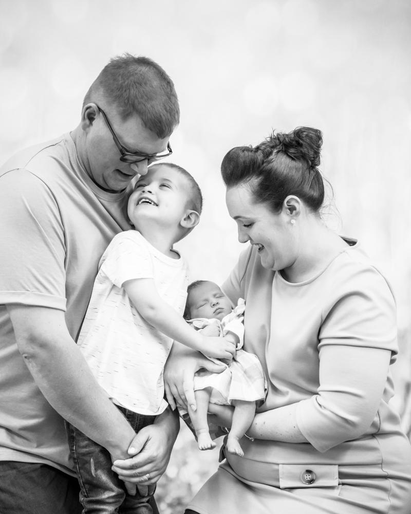 Family cuddle, newborn photographer Cockermouth
