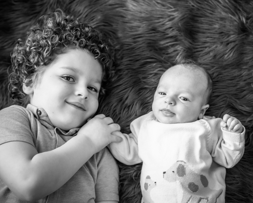 Holding his little brother's hand, baby photographer Aspatria