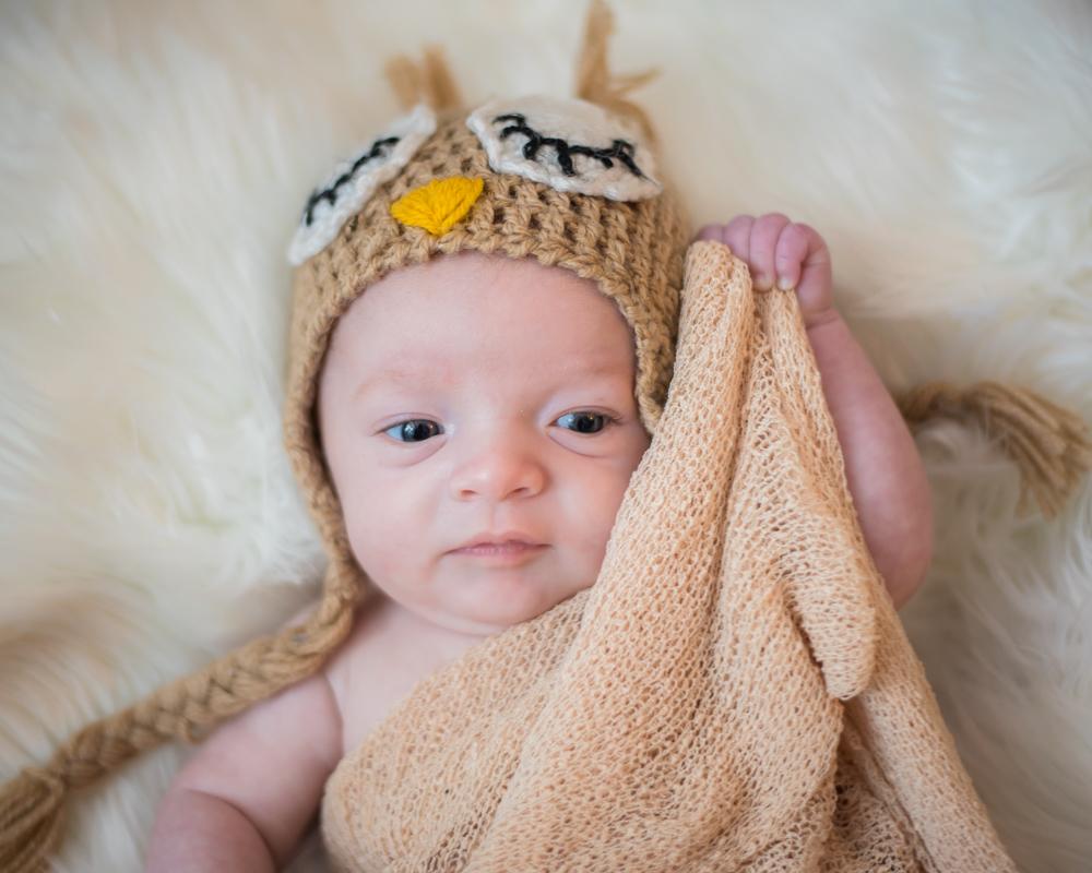 Hiding under cover, newborn photographer Wigton